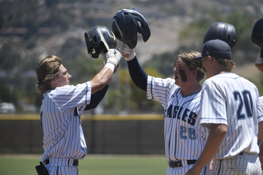 Granite Hills' Austin Smith (left) is congratulated after he hit a solo home run in the first inning Thursday.