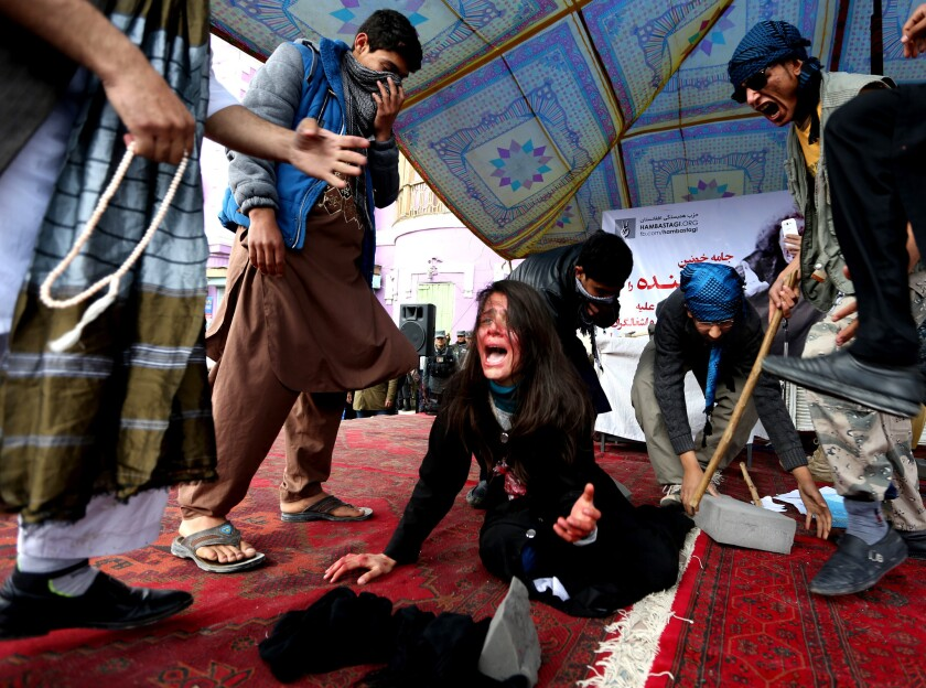 Re-creating killing of woman falsely accused of burning Koran