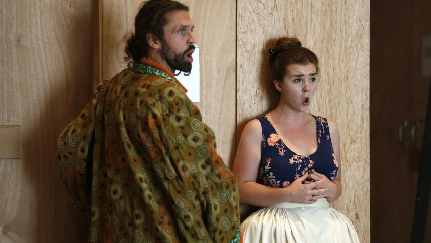 """John Moore, left, and Sarah Shafer rehearse a scene from San Diego Opera's season-opening production of Wolfgang Amadeus Mozart's """"The Marriage of Figaro."""""""