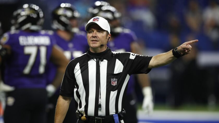 NFL Referee Alex Kemp (55) call a personal foul against the Indianapolis Colts during an NFL preseas