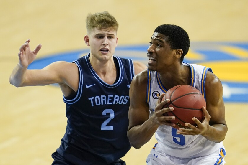 Toreros guard Joey Calcaterra, here against UCLA, is averaging 15.5 points per game in four games.