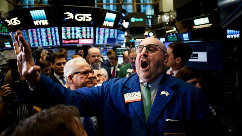 Specialist Peter Giacchi announces the start of trading of shares of Spotify at the New York Stock Exchange on Tuesday.