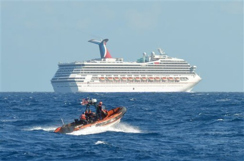 In this image released by the U.S. Coast Guard on Feb. 11, 2013, a small boat belonging to the Coast Guard Cutter Vigorous patrols near the cruise ship Carnival Triumph in the Gulf of Mexico, Feb. 11, 2013. The Carnival Triumph has been floating aimlessly about 150 miles off the Yucatan Peninsula s