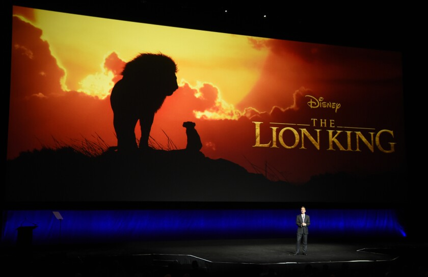 """FILE - In this April 3, 2019, file photo, Sean Bailey, president of Walt Disney Studios Motion Picture Production, discusses the upcoming live-action film """"The Lion King"""" during the Walt Disney Studios Motion Pictures presentation at CinemaCon 2019 at Caesars Palace in Las Vegas. The Walt Disney Co. has apologized to a California school that was charged a $250 licensing fee after showing the company's film """"The Lion King"""" during a fundraiser. Emerson Elementary School in Berkeley was billed by Movie Licensing USA on behalf of Disney for """"illegally screening"""" the film at a """"parent's night out"""" event that raised $800 last year, KPIX-TV reported Thursday, Feb. 5. (Photo by Chris Pizzello/Invision/AP, File)"""