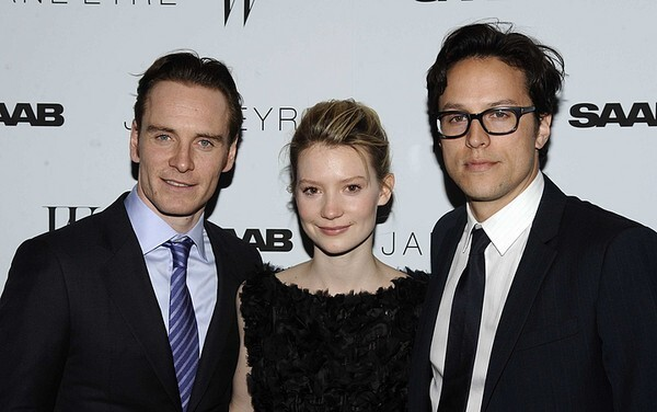 The latest retelling of Charlotte Bronte's classic story of a young girl with a difficult past and an employer with a secret stars Mia Wasikowska, center, as the title character and Michael Fassbender, left, as Rochester. Cary Fukunaga directed the film. The three gather for the premiere of the film at New York's Tribeca Grand Hotel.