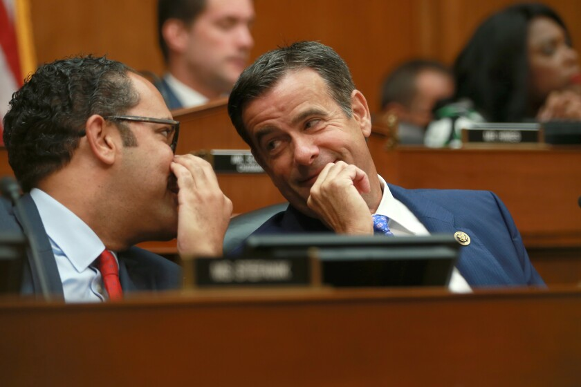 Rep. John Ratcliffe (R-Texas), right, during a hearing last year. He is President Trump's nominee to be director of national intelligence.