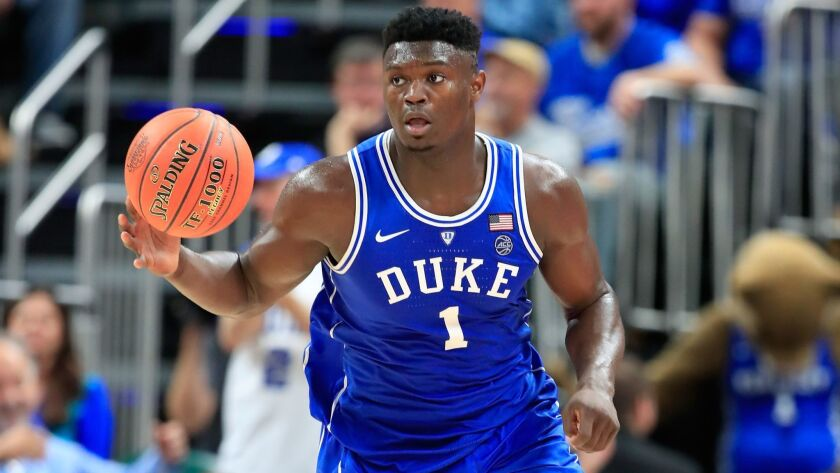 Duke's Zion Williamson dribbles the ball against Kentucky during the State Farm Champions Classic at Bankers Life Fieldhouse on Tuesday in Indianapolis.