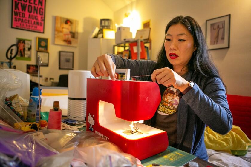 Kristina Wong on her sewing machine