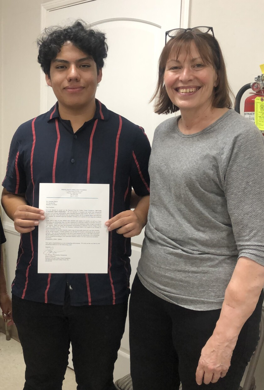Emiliano Ramos, with Susan Randall, president of the Ramona Food & Clothes Closet, is the latest scholarship recipient.
