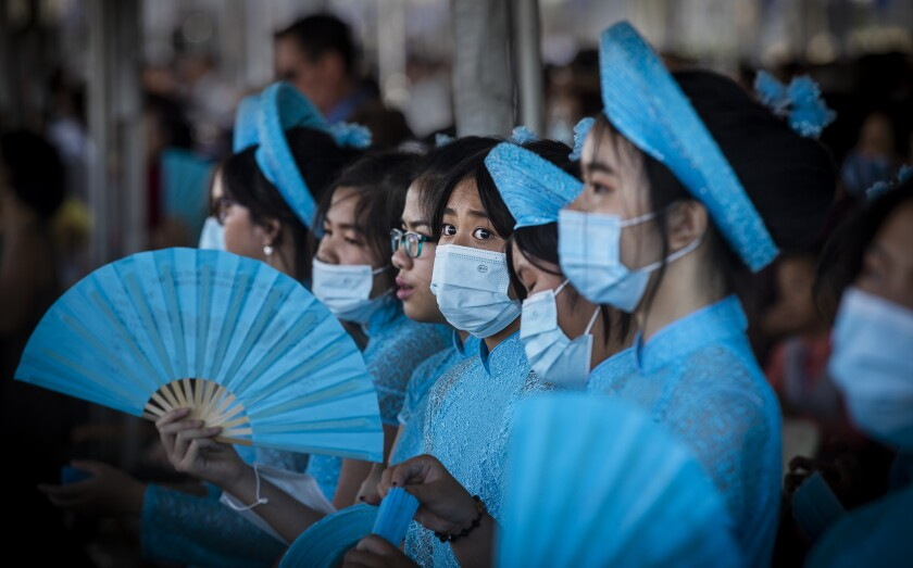 Young people at Christ Cathedral in Garden Grove wear face masks