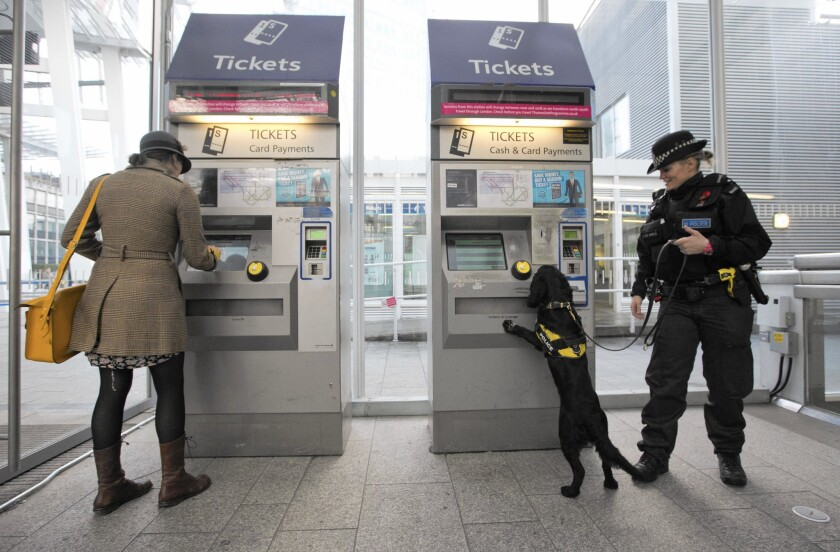 An officer with the British Transport Police patrols with a sniffer dog in London on Nov. 27 as part of Counter-terrorism Awareness Week.