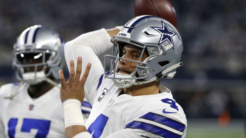 Dallas Cowboys quarterback Dak Prescott throws a pass during warmups before a wild-card game against the Seattle Seahawks in Arlington, Texas, on Saturday.
