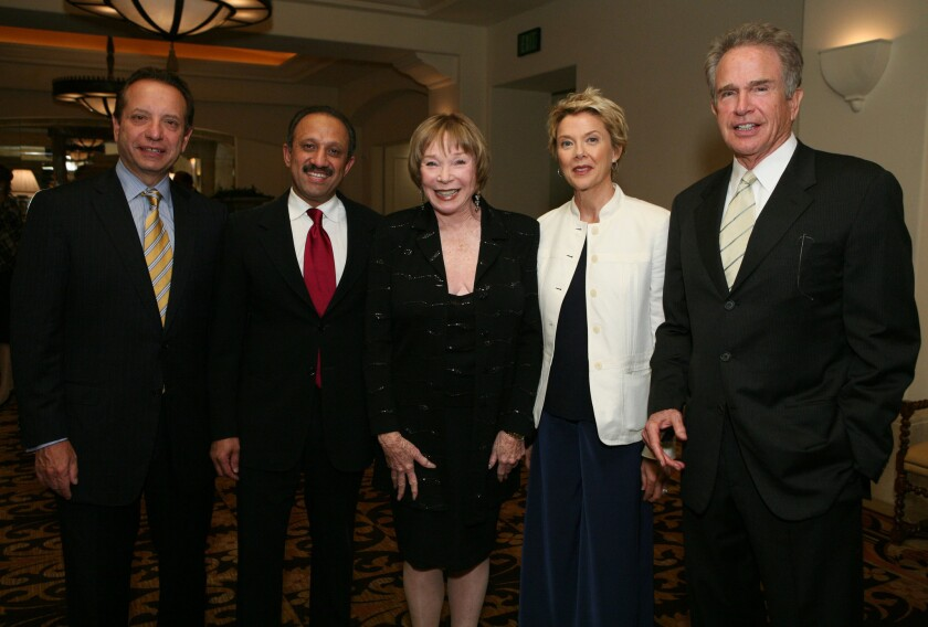 Then-Dean Carmen A. Puliafito, left, Dr. Inderbir Gill, actress Shirley MacLaine, actress Annette Bening and actor Warren Beatty at a USC event at the Montage Beverly Hills hotel in May 2009.