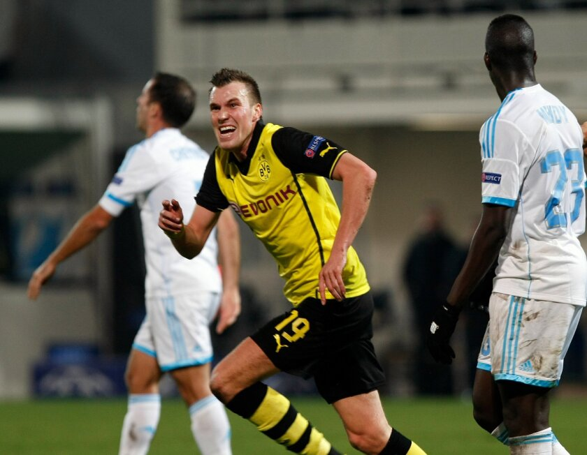 Dortmund's Kevin Grosskreutz, celebrates his side's 2nd goal during the Group F Champions League soccer match between Olympique Marseille and Borussia Dortmund at the Velodrome stadium in Marseille, Southern France, Wednesday, Dec. 11, 2013. (AP Photo/Claude Paris)