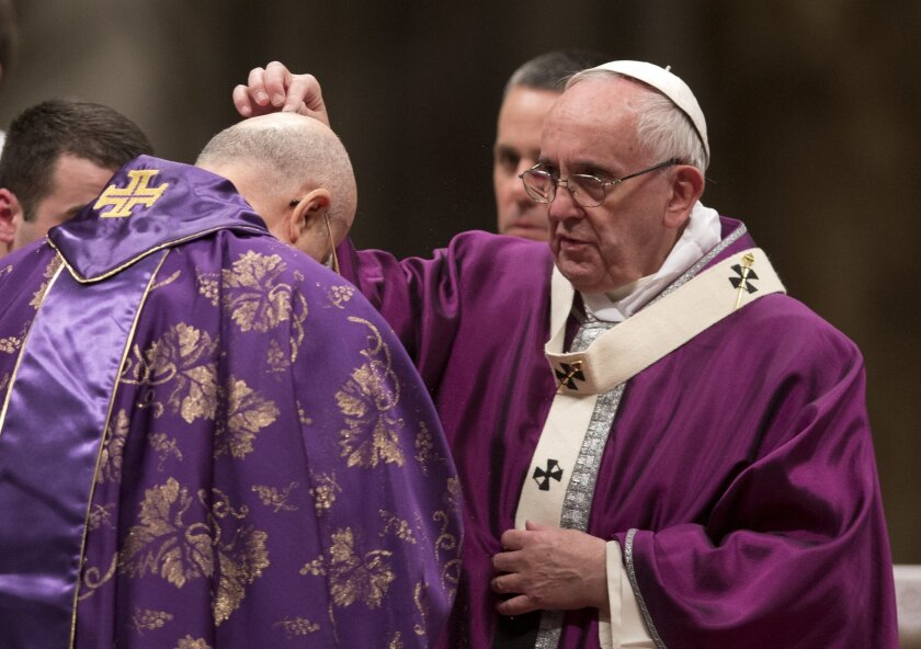 Pope Francis places ashes on the head of Cardinal Tarcisio Bertone during the Ash Wednesday mass, in St. Peter's Basilica at the Vatican, Wednesday, Feb. 10, 2016. Pope Francis has smudged ashes on the bowed heads of prelates, nuns and ordinary Catholics during Ash Wednesday Mass in St. Peter's Bas
