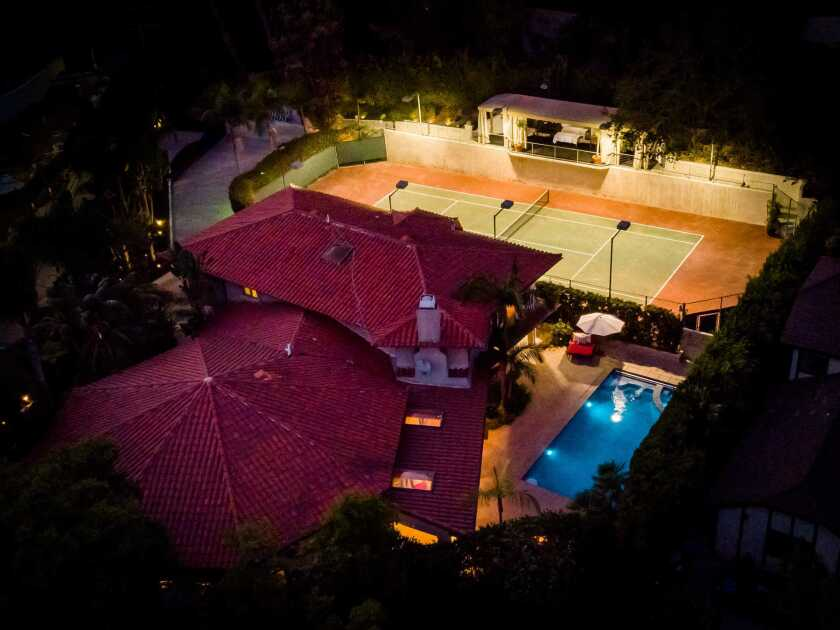 The former home of Chris Pratt and Anna Faris has a pool and tennis court.