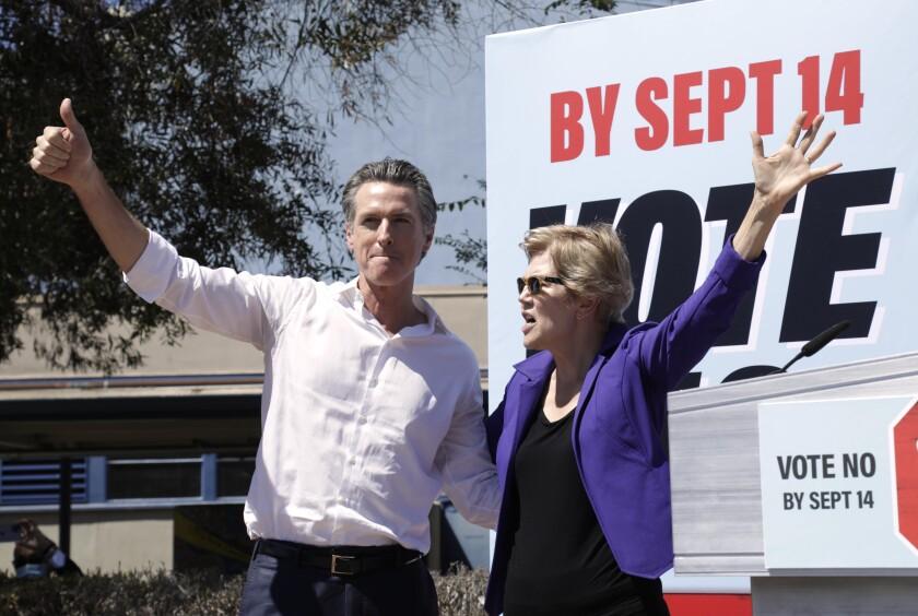 California Gov. Gavin Newsom and U.S. Sen. Elizabeth Warren greet a crowd of supporters.
