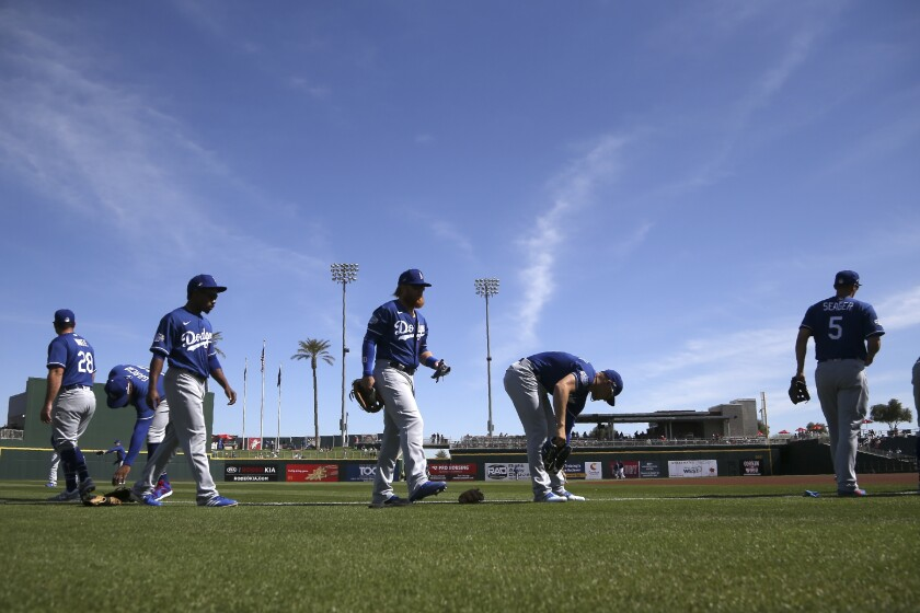 Los Angeles Dodgers players warm up prior to a spring training game.