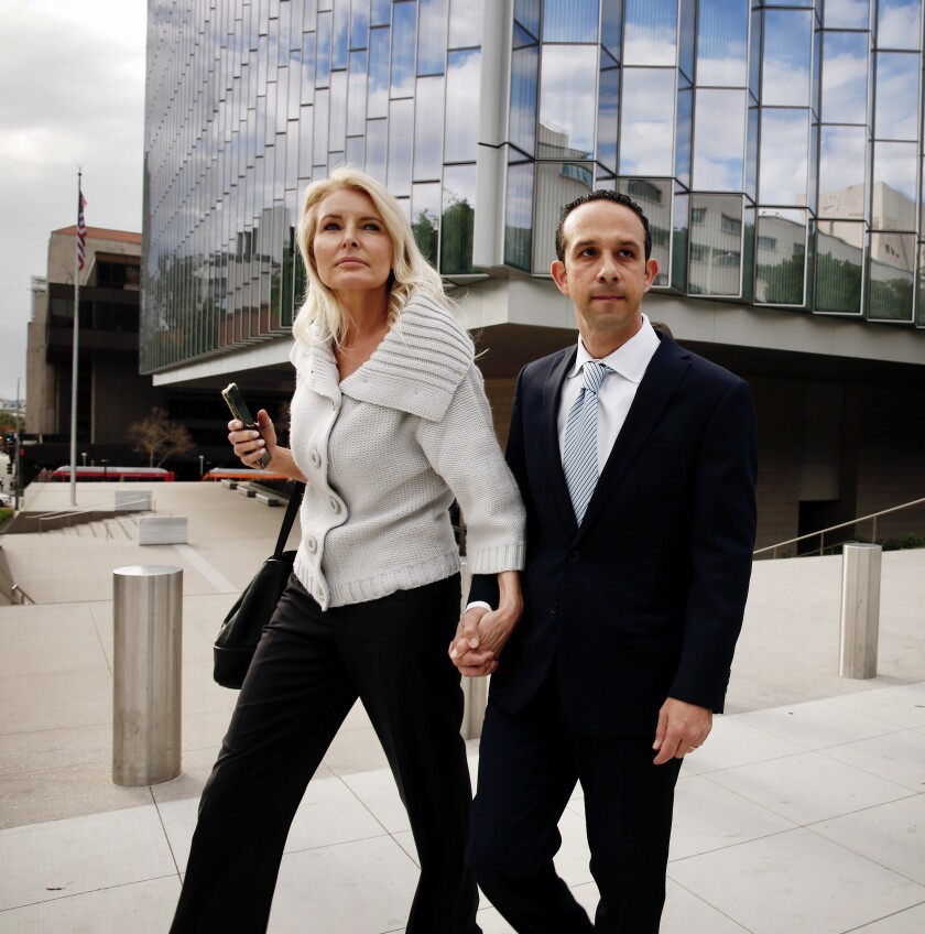 Former Los Angeles City Councilman Mitchell Englander leaves federal court in downtown Los Angeles with his wife, Jayne, in mid-March.