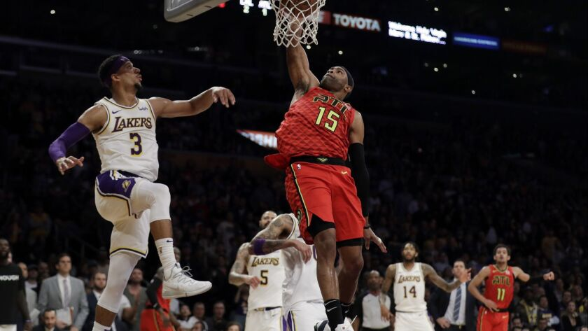 The Atlanta Hawks' Vince Carter dunks next to the Lakers' Josh Hart during a Nov. 11 game at Staples Center.