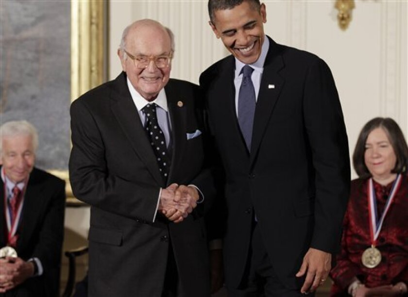 President Barack Obama stands with Harry W. Coover, who invented cyanoacrylate glue, commonly known as Super Glue, for Eastman Chemical Co., as he hosts a ceremony for recipients of the National Medal of Science and the National Medal of Technology and Innovation, the highest honors bestowed by the