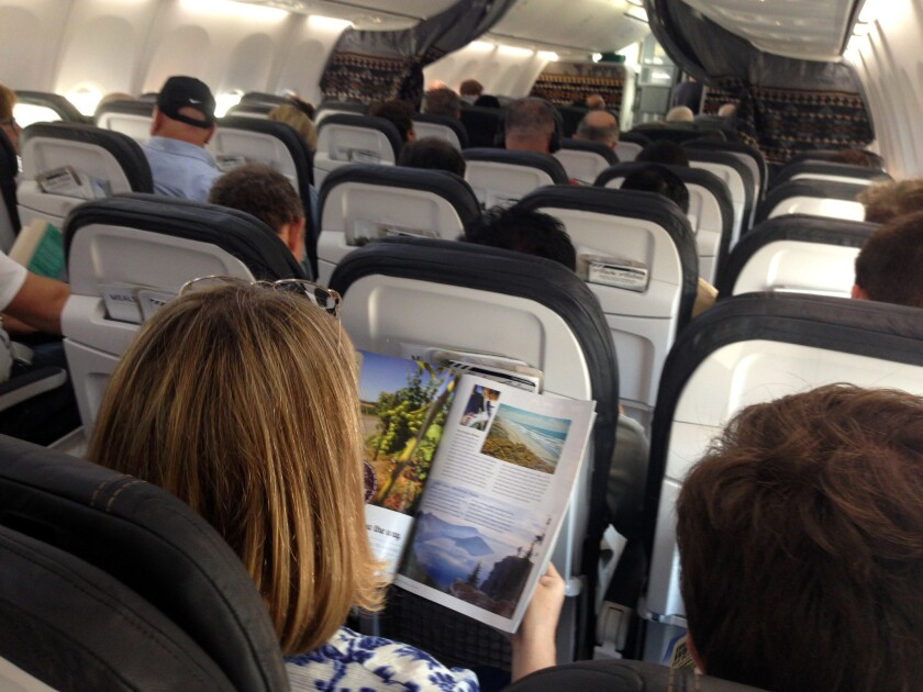 Passengers pass the time on an Alaska Airlines flight in August 2014.