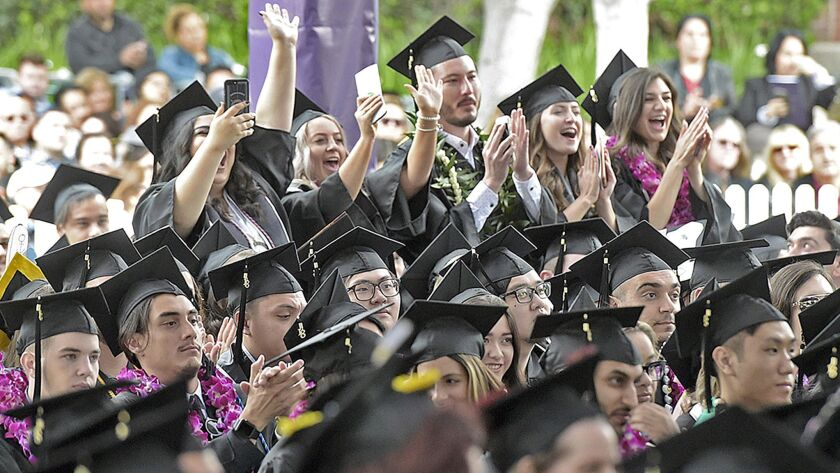 Some of the 344 graduates wave to their friends on stage during the 2018 graduating ceremony at Wood