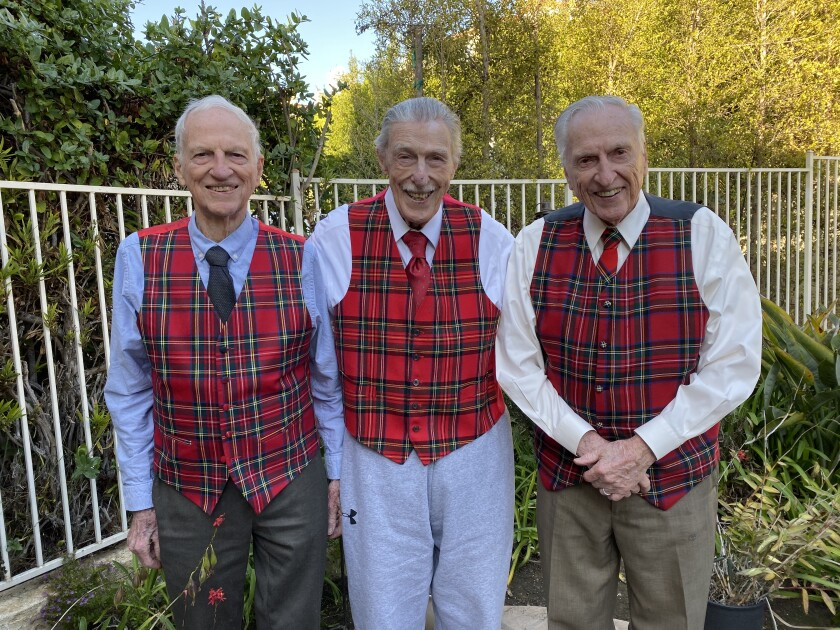 Ray Stewart, 93, Bill Stewart, 100, and Stan Stewart, the baby, pose in the backyard of Stan's La Jolla house on his 90th birthday. The vests honor their Scottish heritage.