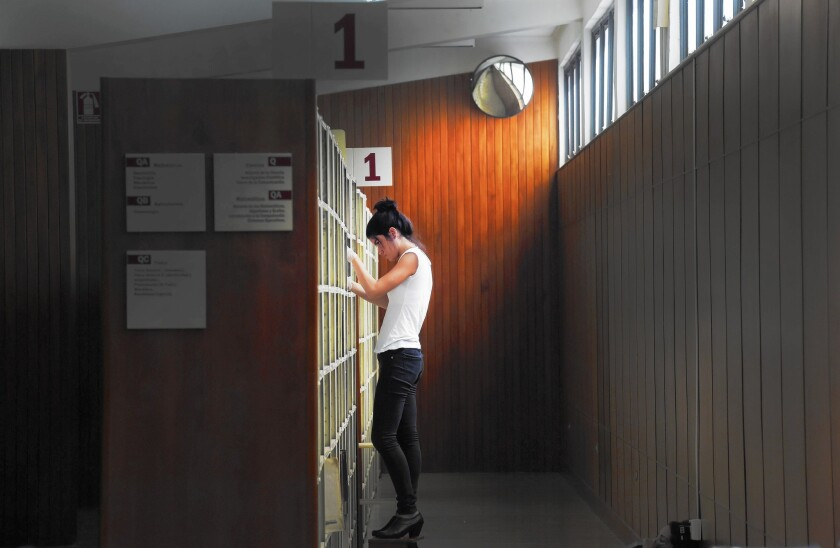 A student at the sciences library at Central University of Venezuela, which has been closed since September because of what administrators say are funding woes.