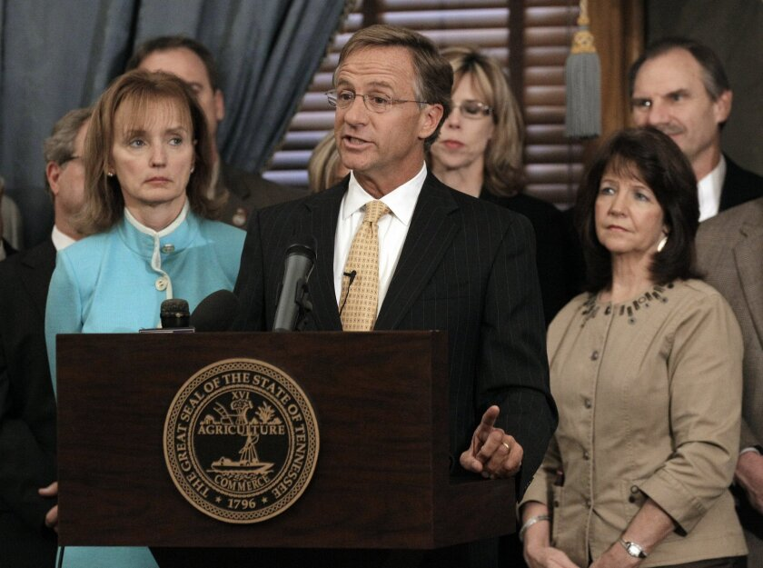 FILE - In this Jan. 10, 2012 file photo, Rep. Sheila Butt, R-Columbia, lower right, listens as Gov. Bill Haslam, center, talks about his legislative agenda on the opening day of the second session of the 107th General Assembly in Nashville, Tenn. The Tennessee Legislative Black Caucus has said Butt should apologize for a Facebook post they say is racist. (AP Photo/Mark Humphrey, File)