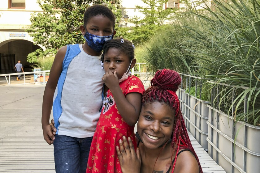 Erica Wilkins with children Kabir Grant, 6, and Nevaeh Grant, 4