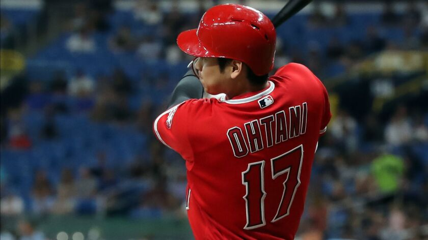 Angels' Shohei Ohtani hits a seventh-inning single Thursday against Tampa Bay to complete his first career cycle.