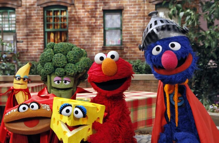 "Elmo and Super Grover in ""Sesame Street"""