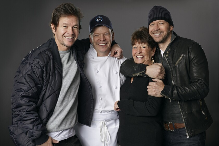 Mark, Paul, mom Alma and Donnie Wahlberg are bringing their Wahlburgers to Las Vegas by the end of the year.