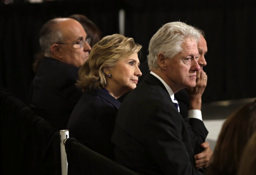 Former New York Mayor Rudolph Giuliani, Hillary Clinton and former President Bill Clinton attend a dedication ceremony last month at the National September 11 Memorial Museum in New York.