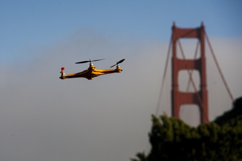 A drone flies in front of the Golden Gate Bridge in June. The FAA hasn't written regulations for rapidly evolving drone technology, and states have begun stepping into the federal void.