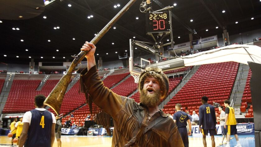 SAN DIEGO, March 15, 2018 | Troy Clemons, portraying West Virginia's mascot The Mountaineer, lets ou