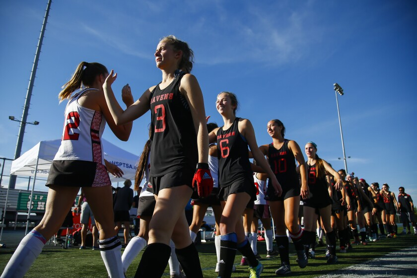 Canyon Crest Academy and Vista high five after the Ravens 2-1 win over the Panthers for the Division 1 championship.