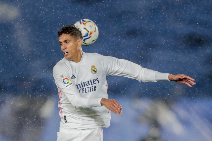 FILE - In this Saturday, April 24, 2021 file photo, Real Madrid's Raphael Varane heads the ball during the Spanish La Liga soccer match between Real Madrid and Betis at the Alfredo di Stefano stadium in Madrid, Spain. Manchester United has reached an agreement with Real Madrid to sign center-back Raphael Varane, the Premier League club said Tuesday July 27, 2021. (AP Photo/Bernat Armangue, File)