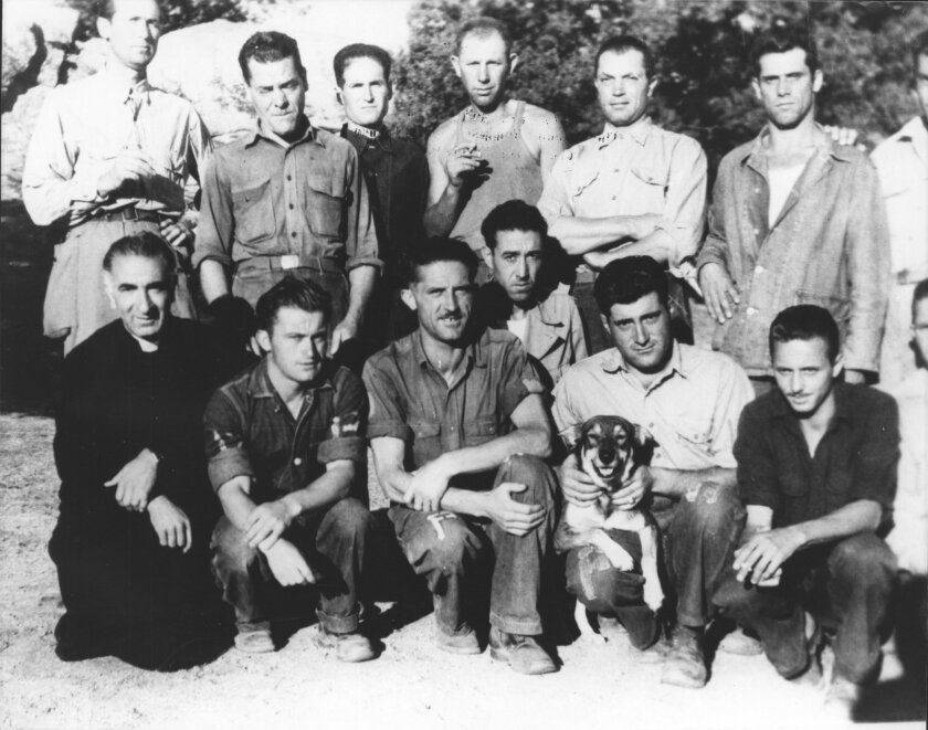 The 10th and 28th Cavalry Regiments paraded at Camp Lockett in 1944. The camp  as it appeared after its completion in 1941. Italian prisoners of war with a stray dog that became their mascot, and Father John Garrone of the San Diego Diocese, at left. (Mountain Empire Historical Society)