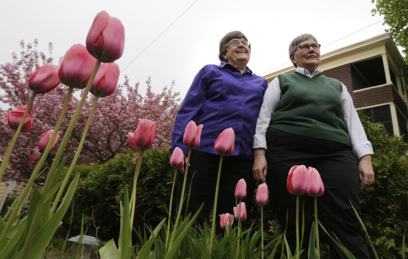 Marcia Hams, left, and her wife, Susan Shepherd, stand outside their home in Cambridge, Mass. They were first in line to get a license as Massachusetts legalized same-sex marriage, and wed on May 17, 2004.