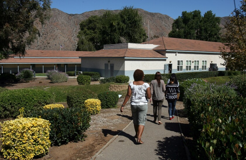 Students and teachers walk the San Pasqual Academy campus during a class change
