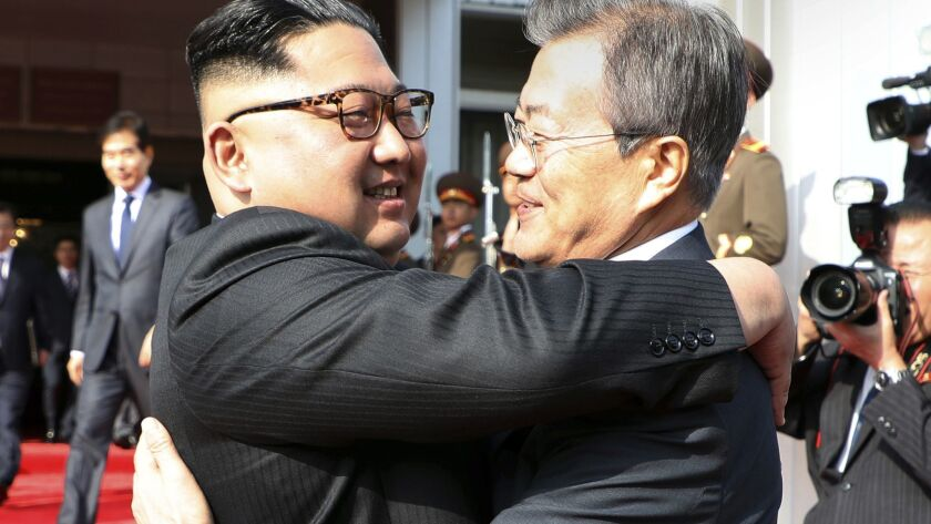 North Korea's Kim Jong Un and South Korea's Moon Jae-in embrace after meeting in 2018.