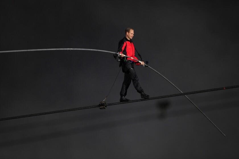 Nik Wallenda makes his historic walk on a wire across Niagara Falls in 2012.