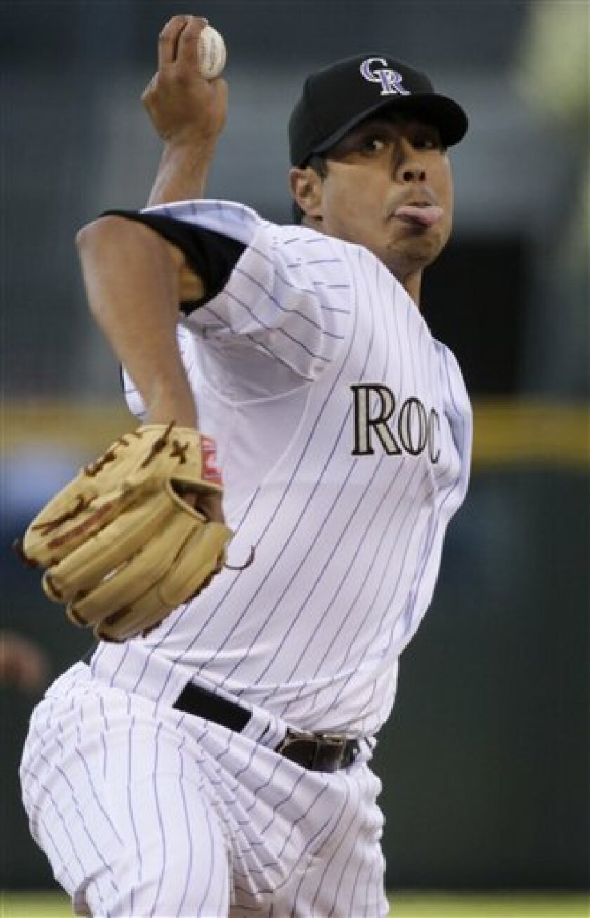 Colorado Rockies starting pitcher Jorge De La Rosa throws to Arizona Diamondbacks batter Justin Upton in the first inning of an MLB baseball game in Denver on Saturday, April 2, 2011. (AP Photo/Joe Mahoney)