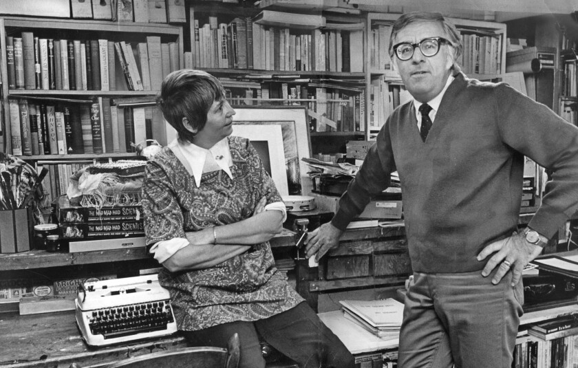 Ray Bradbury at home with his wife, Maggie, in 1970 in a room lined with books.