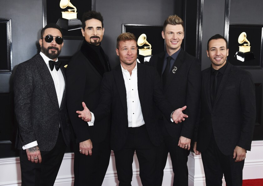 """FILE - AJ McLean, from left, Kevin Richardson, Brian Littrell, Nick Carter, and Howie Dorough of The Backstreet Boys appear at the 61st annual Grammy Awards in Los Angeles on Feb. 10, 2019. The pioneering boy band is returning to the Las Vegas Strip with """"A Very Backstreet Christmas Party,"""" a series of 12 holiday shows at the Planet Hollywood resort this November and December. (Photo by Jordan Strauss/Invision/AP, File)"""