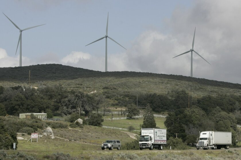 Thursday April 7th 2011 Alpine CA USA- Cars and trucks move westward along Interstate 8 as wind turbines spin near the Golden Acorn Casino ahead of a wind advisory for the mountain passes in the east county. Photo by David Brooks /  Union-Tribune MANDATORY PHOTO CREDIT: DAVID BROOKS/UNION-TRIBUNE/Z