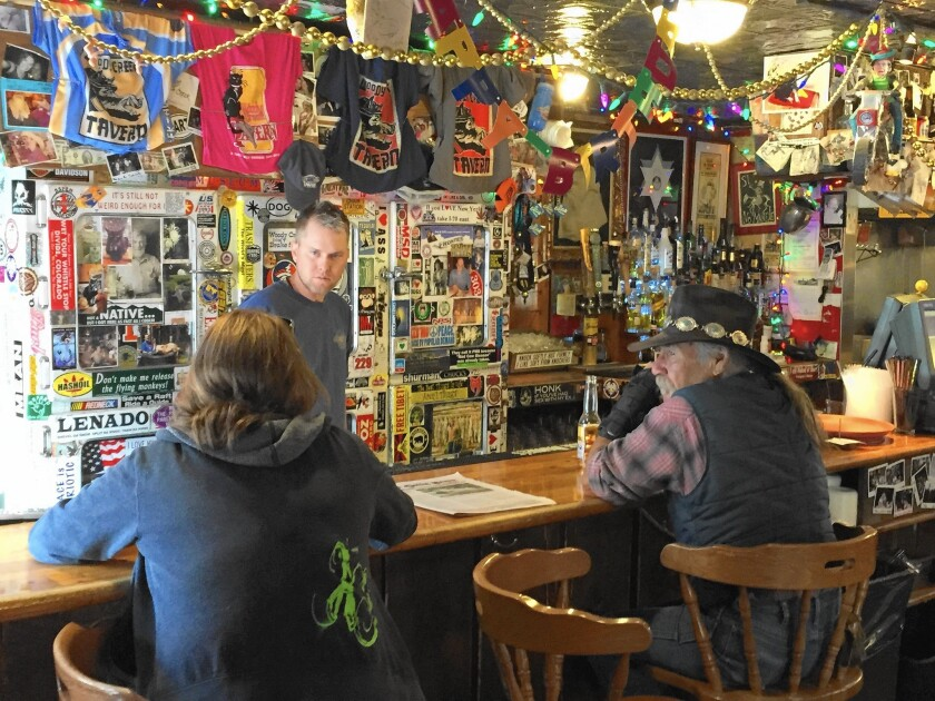 Bartender Eric Kincade talks with regulars at the Woody Creek Tavern, a longtime hangout of the writer Hunter S. Thompson.