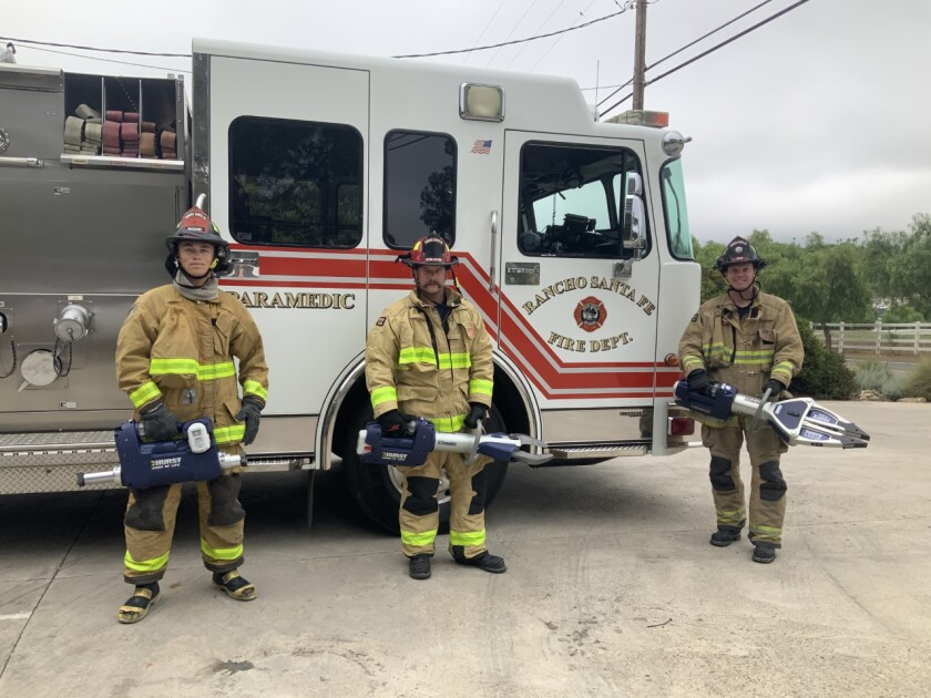 Elfin Forest volunteer firefighters show the Jaws of Life equipment